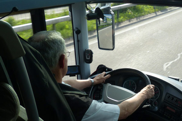 Bus Driver on the road taking guests to Disney World 600
