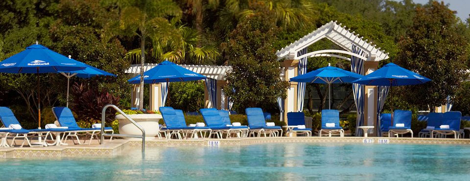 Renaissance Hotel Orlando SeaWorld Outdoor Pool with Blue Umbrellas and Lounge Chairs wide