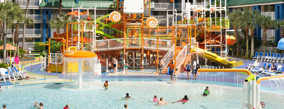 View of the large water park zone with zero entry pool and water slides at the Holiday Inn Resort Orlando Suites Water Park wide