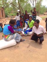 A deacon talking to a beneficiary.