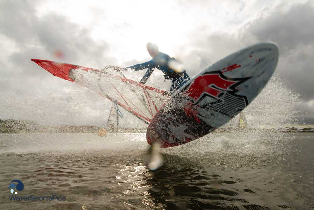 early morning windsurf session with strobes and F2/Severne/Mystic rider  Rick Jendrusch at Brouwersdam, Ouddorp, The Netherlands on 18 August  2013.