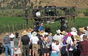 Farmer Bill Brammer (center, in blue shirt) leads a tour of his tomato fields in the San Pasqual Agricultural Reserve