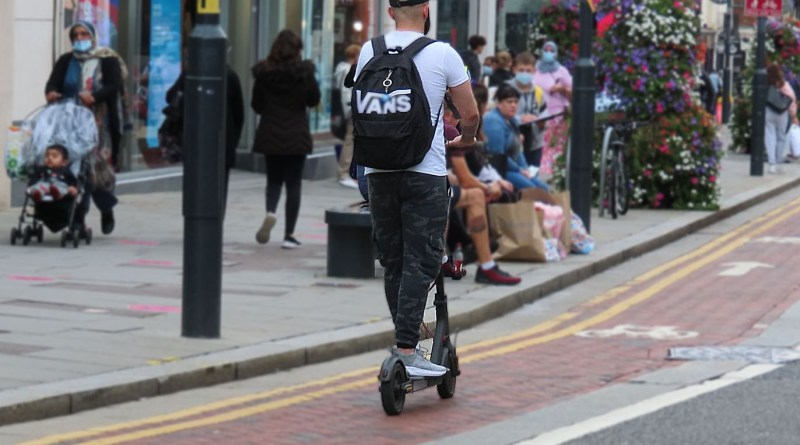 scooter,man,male,high street,road,people