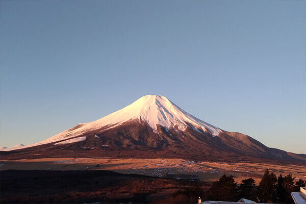 Be greeted by a view of red Fuji from the guest room