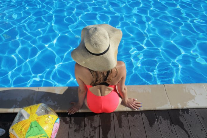 sitting by the swimming pool