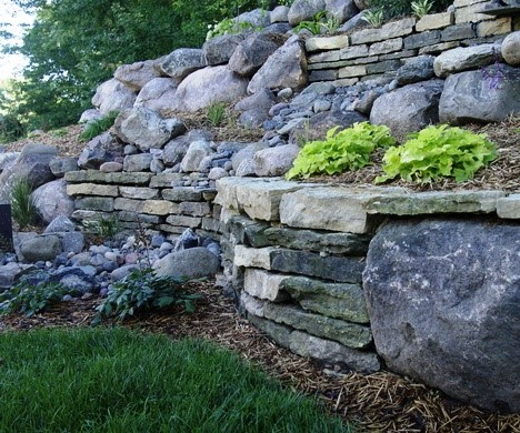 Plot Where The Retaining Wall Will Sit At The Bottom Of The Slope, Using  Stakes And ...