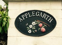 'Applegarth' name plaque in front of English house