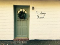 'Foxley Bank' name plaque on side of English house
