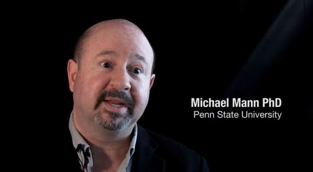 Michael vs Michael: Mann attacks Moore as Russian Stooge.