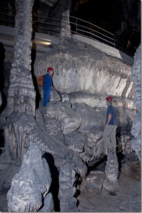 Researchers study the levels of phreatic overgrowth on speleothems in Teatro Room, Artá Cave Credit A. Merino