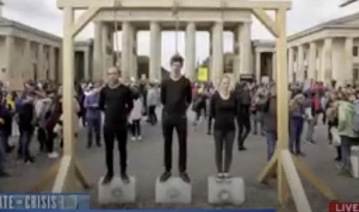 Climate protestors mock hanging