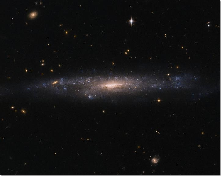 IMAGE: NASA/ESA Hubble Space Telescope image capturing UGC 477, a low surface brightness galaxy located just over 110 million light-years away in the constellation of Pisces (The Fish). Credit: ESA/Hubble & NASA Acknowledgement: Judy Schmidt