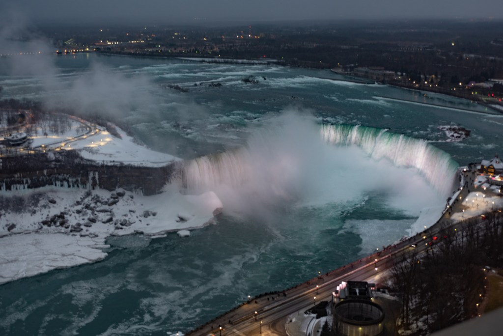 Watch the frozen Niagara Falls come alive as the night falls