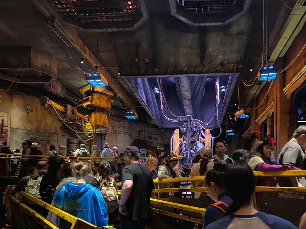 The queue winds around workshops and jet engines at Star Wars Smugglers Run at Disneyworld