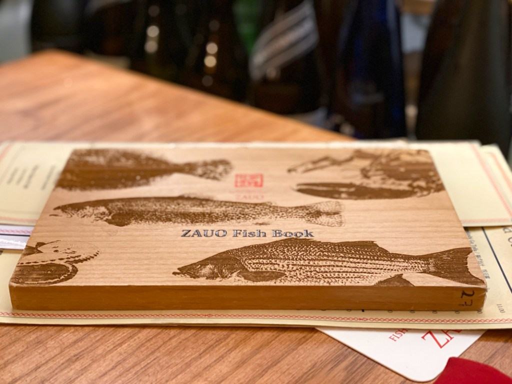 The menu of amazing fish and seafood is wooden at zauo chelsea new york