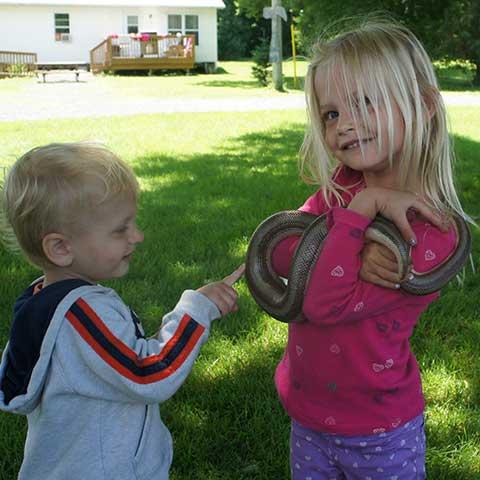 Holding a snake