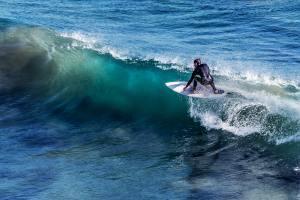 Male surfer riding a wave.
