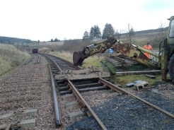 The Hymac digger is used to move concrete sleepers from the broken down panels ready to be dropped into the running line as part of the upgrade programme