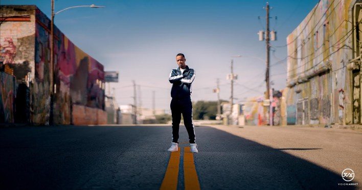 Cino Slim standing in the street