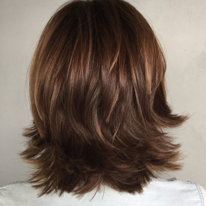 layered flipped out hair - wavy haircut