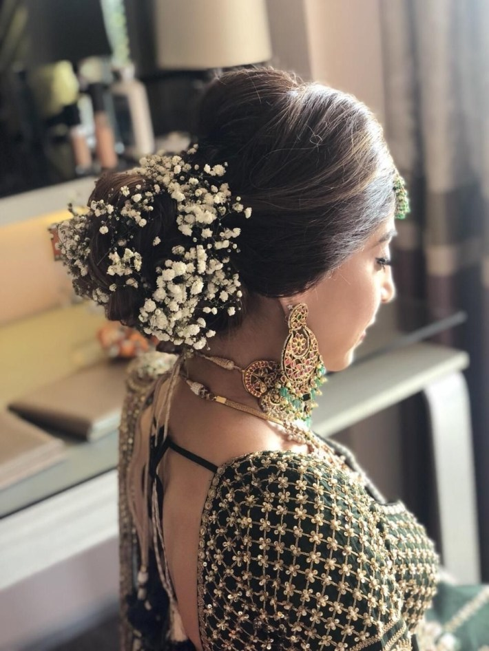 Pretty Bridal Bun With Baby Breath Flowers For An Indian Wedding with Indian Bridal Hair Accessories List