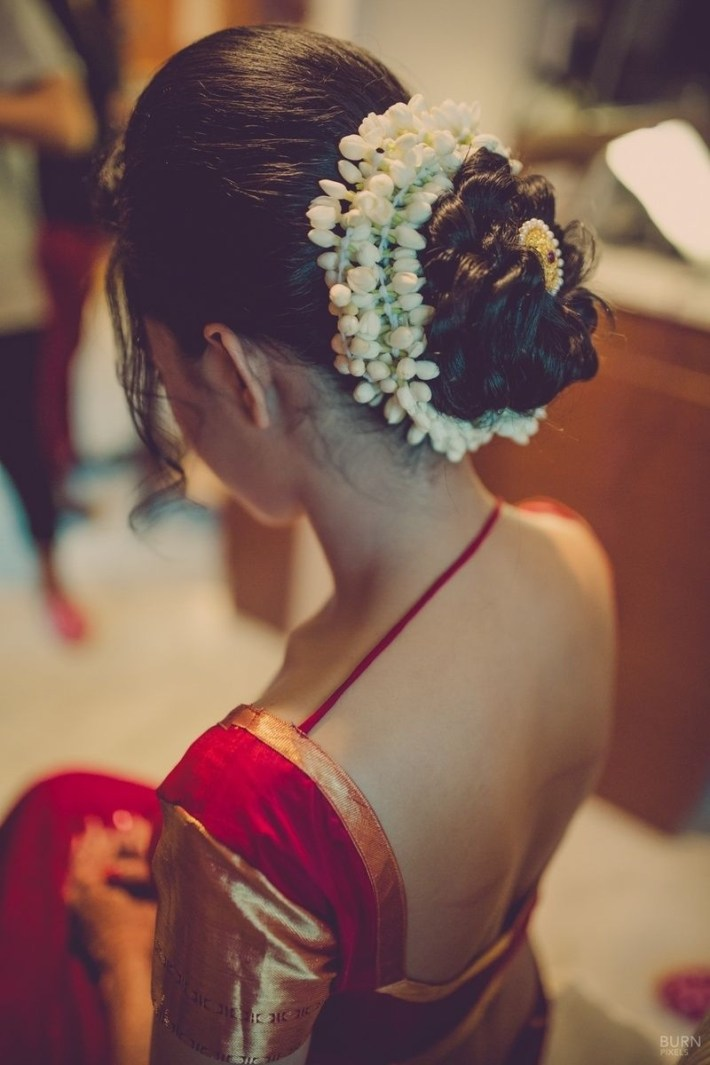 Mogra Flowers Encase Her Bridal Bun In A Traditional Style With Gold with regard to Bun Hairstyle For Indian Wedding With Flower