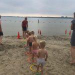 Multisportles Ouder en kind aan het strand