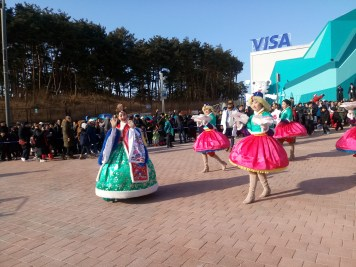 mini parade in front of the visa superstore after lunch