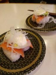 salmon and avocado nigiri (smallest piece of avocado under a mound of onion)