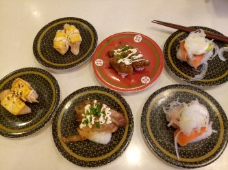 left to right: flamed fatty salmon with cheese, char-grilled short rib with mayonnaise, same salmon and avocado nigiri from previous page