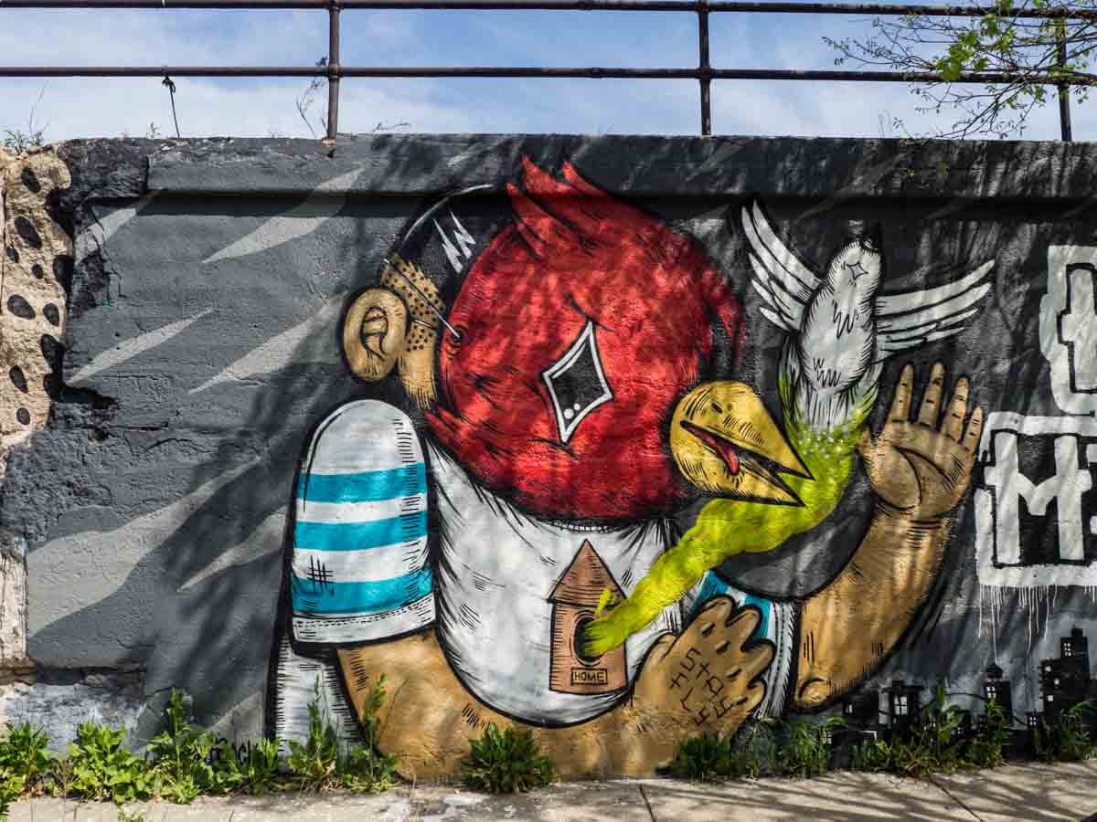 Sentrock artist Bird Mask street art in Pilsen Chicago