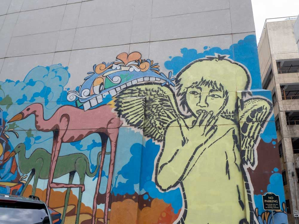 Angels & Monsters mural in Nashville- yellow angel figure