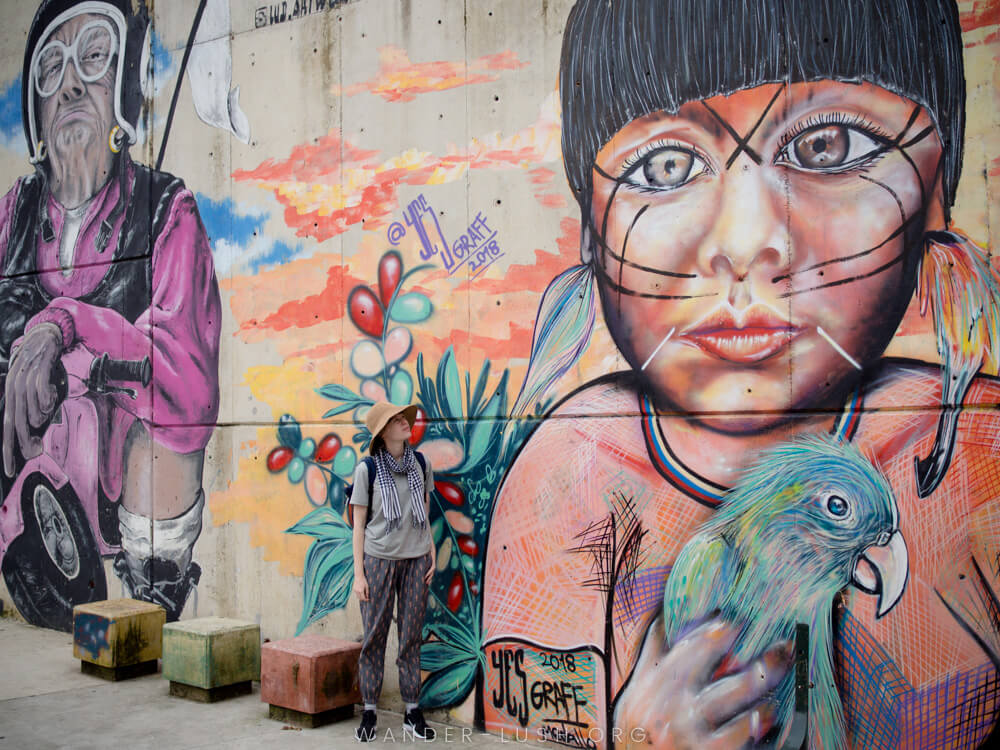 Colombia street art city: Medallin Comuna 13 mural with woman in the foreground