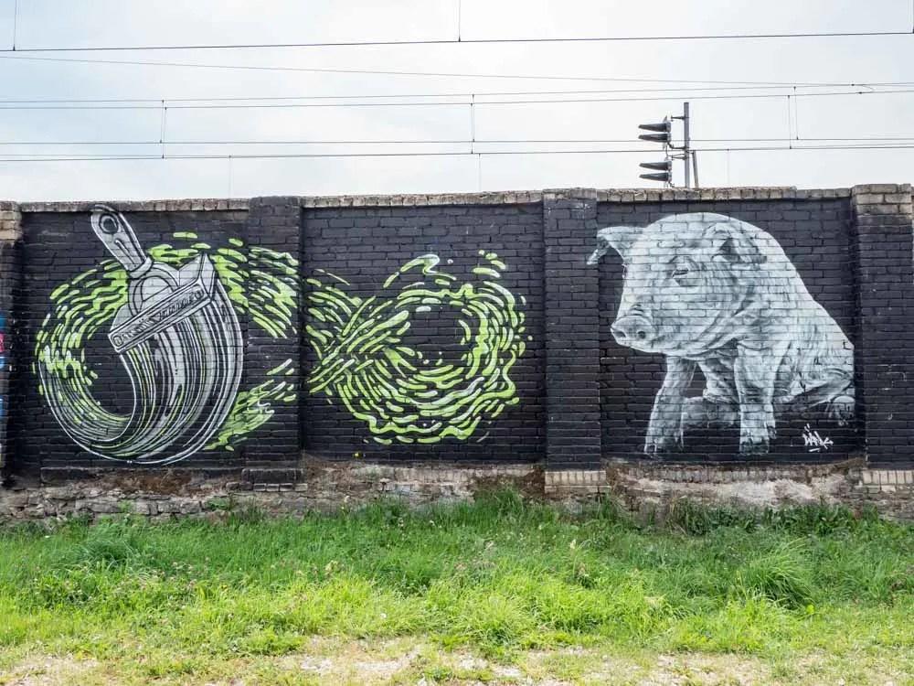 Tallinn Telliskivi parking lot pig and paint brush mural