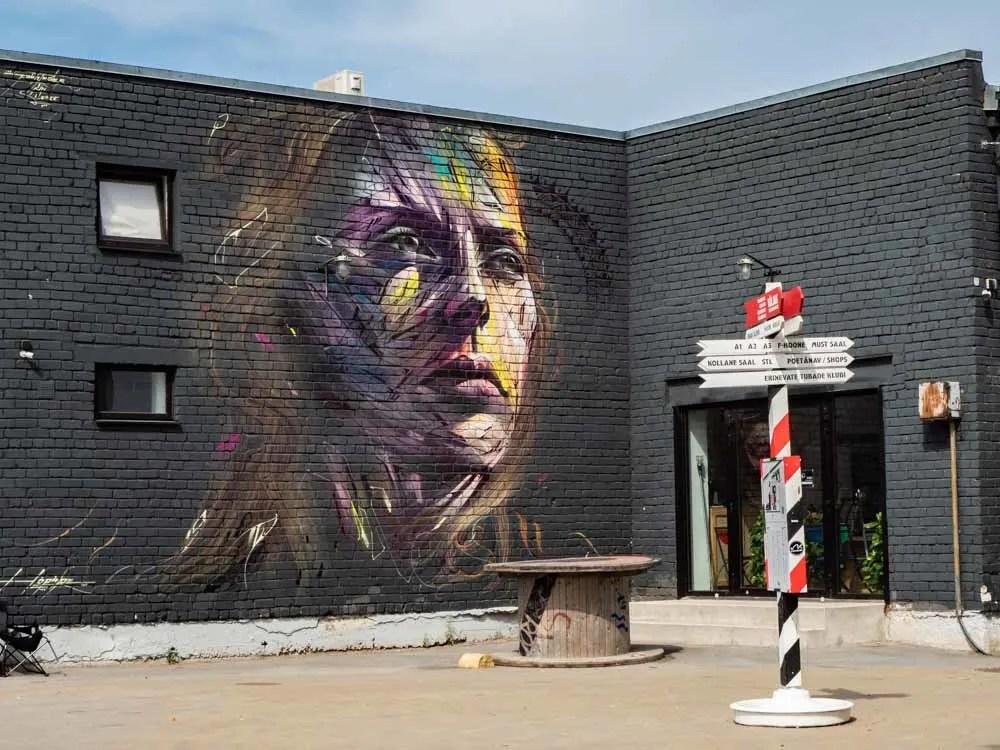Tallinn mural in Telliskivi purple portrait
