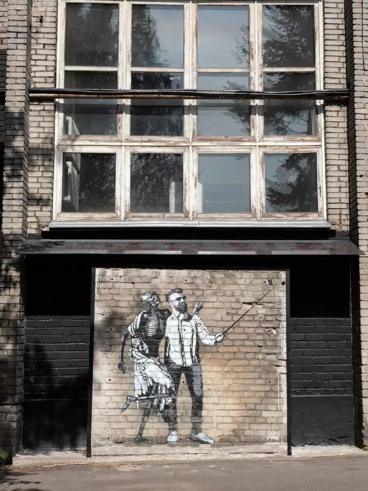 Tallinn Estonia street art stencil selfie and skeleton