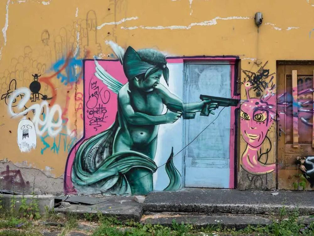 Tartu Karlova graffiti character with gun