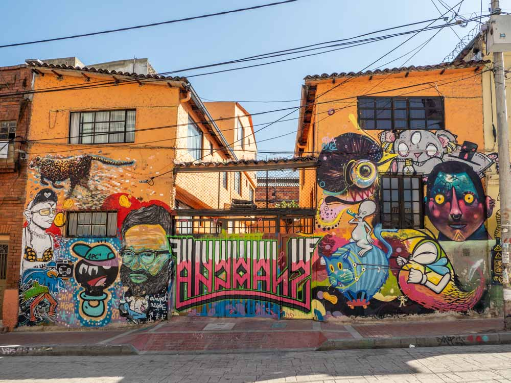 Bogota graffiti wall in La Calendaria. Graffiti, cheetah and faces in multi colors