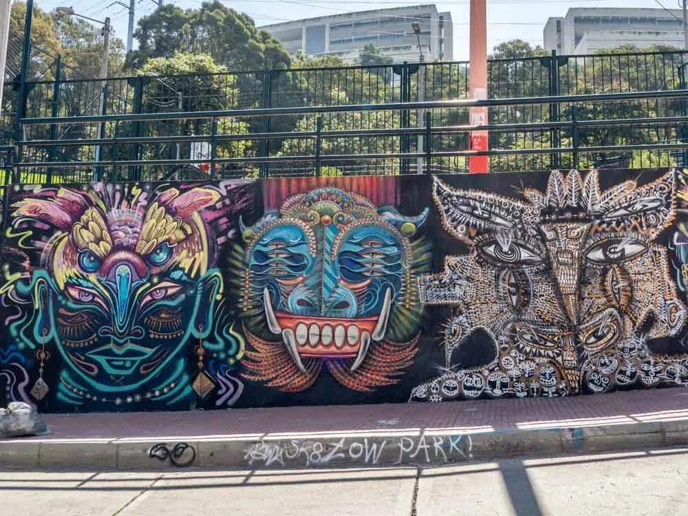 Bogota graffiti tour Parque la Concordia- mural on park wall with three masks
