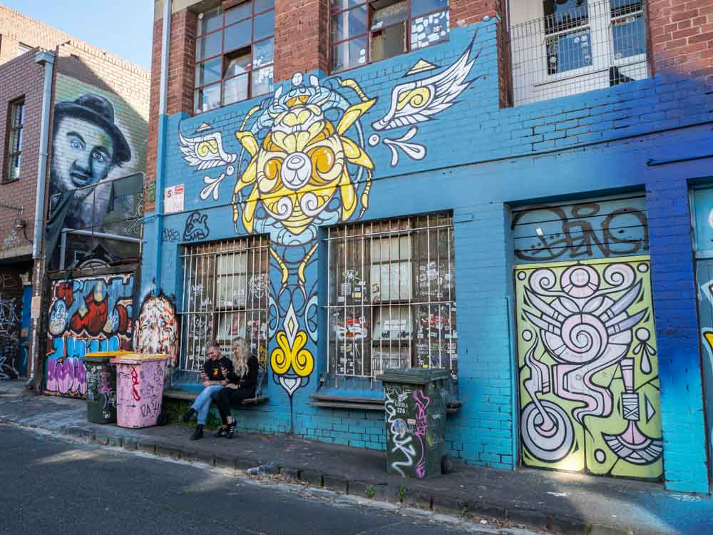 Juddy Roller in Melbourne. Mural by Phibs with blue and yellow characters