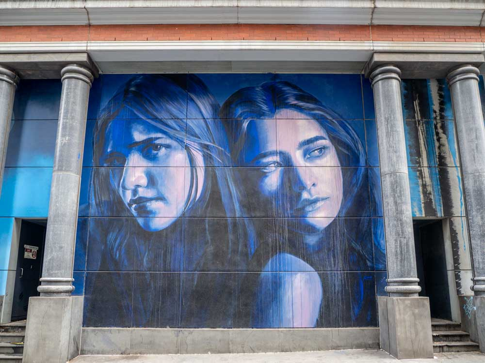 Melbourne Rone mural Southern Cross Station. two women in blue