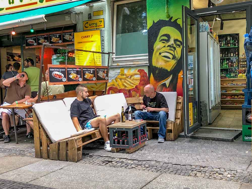 Berlin Kreuzberg convenience store with men having drinks