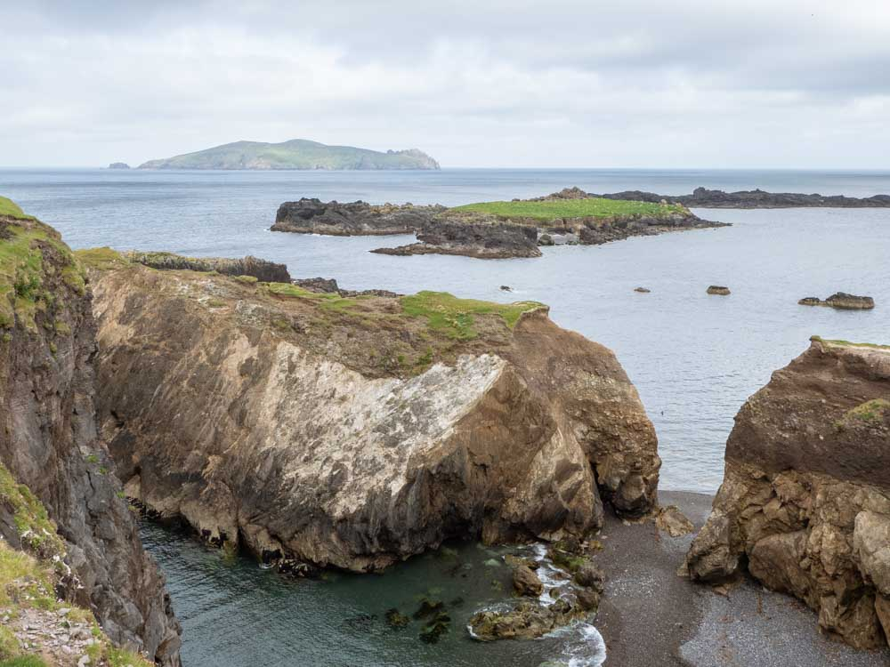Ireland Great Blasket Island shoreline. Rocks with ocean and islands