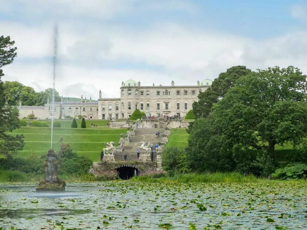 Powerscourt gardens near Dublin Ireland. Manor house with fountain and walkways