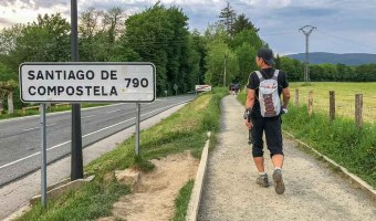 Camino de Santiago guidebooks: Santiago sign and trail