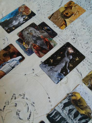 hand made tarot cards in Celtic Cross spread on lace tablecloth
