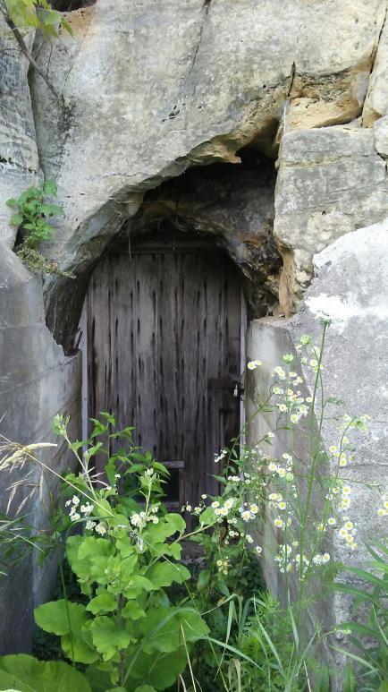 rustic door hidden in a rock outcropping