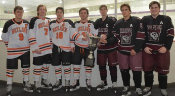 [Photo credit: Carla Stafford] The captains from both the Wayland and Weston boys varsity hockey teams pose with the Post Road Cup they will be competing for at the 2nd Annual Wayland Weston Hockey Night at Rivers on Saturday, February 10th at 7pm. Pictured are (l. to r.) Wayland captains Michael Jones, Joe Lydon, Riley Bonner and Joe Lyons with Weston captains Thomas Burke, Michael Sacco and Preston Grundy.