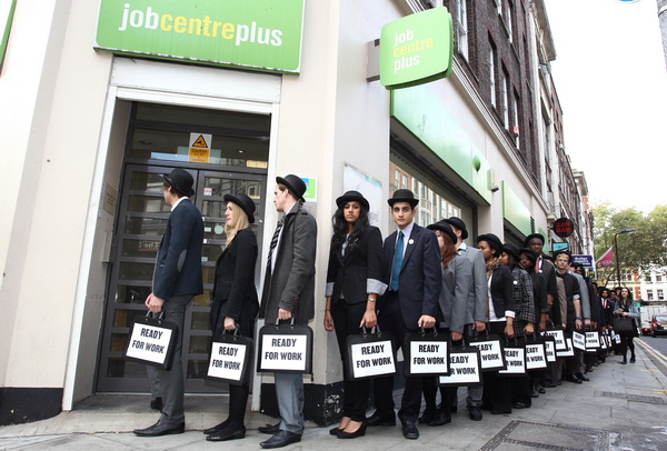 UK young unemployed congregate at job centre, London , jobless