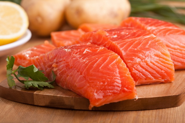 three salmon pieces on a chopping board